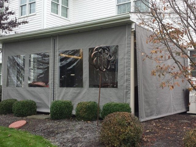 canvas with vinyl window patio enclosure. Drop curtain weighted with steel bar can be raised when not needed.