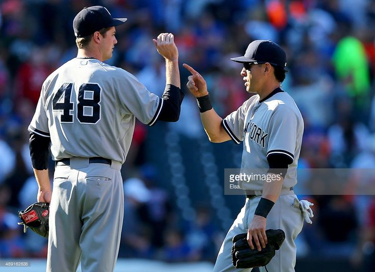Andrew Miller #48 of the New York Yankees celebrates the win with teammate Jacoby Ellsbury #22 after the game against the New York Mets during interleague play on September 19, 2015 at Citi Field in the Flushing neighborhood of the Queens borough of New York City.The New York Yankees defeated the New York Mets 5-0.