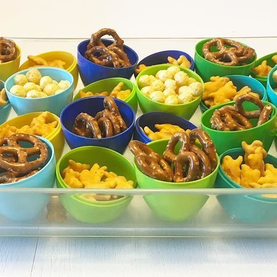 Spring Break Snack Time Fun: I saw this cute idea recently and thought I'd try it out when we had friends over for a play date yesterday. Plastic Easter Eggs filled with Snyder's Pretzels, Annie's Cheddar Bunnies, & Gorilla Munch Cereal. Such a colorful way to display kid snacks in the Spring. #snacksforkids #easterfun #eastereggs #playdate #funforkids #annies #cheddarbunnies #pretzels #gorillamunch #plasticeggs #snacktime #snacktime #momhack #momhacks #momlifeisthebestlife #momlife #ki...