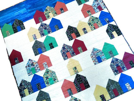 Houses Art Quilt - Village Fabric Wall Hanging - Modern Suburbs Lap Quilt - Quilted Sofa Throw - Dorm Quilt - Fiber Art - Handmade For Sale House Art Quilt is a modern rendition of many centuries of houses a quilting design. Artful houses are rendered in wonderful modern prints contrast with tone on tone colored houses. Although only 10 fabrics were used in the structures and doors it feels like each is a unique home. Did you pick your favorite? Created with 10 quilt shop quality cotton…