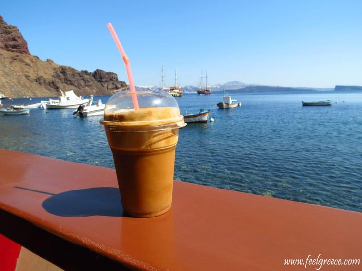 Plastic cup of frappe coffee at Thirasia island, Santorini