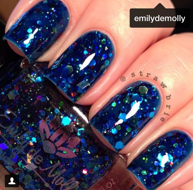 This nail polish reminds me of a peacock.