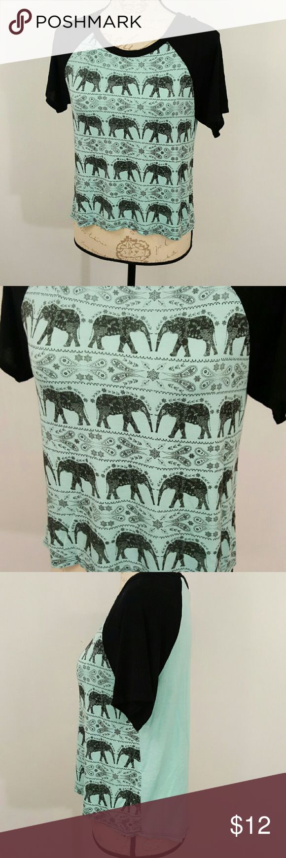 Rue 21 Blue Green Black Elephant Shirt Rayon M This is a blue sea green and black elephant blouse. Size M. 95% Rayon and 5% Spandex. It is Rue 21 brand.  Nonsmoking home Rue 21 Tops Tees - Short Sleeve