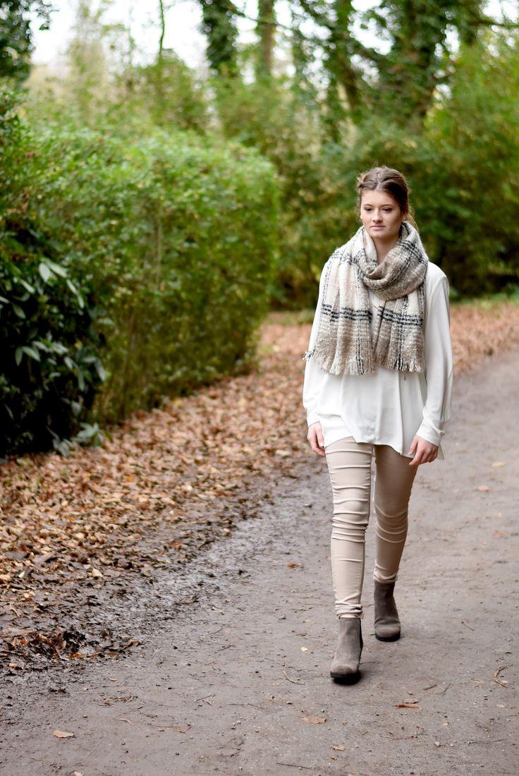 Verhoog het 'gezellige' gevoel van je outfit met een dikke sjaal
