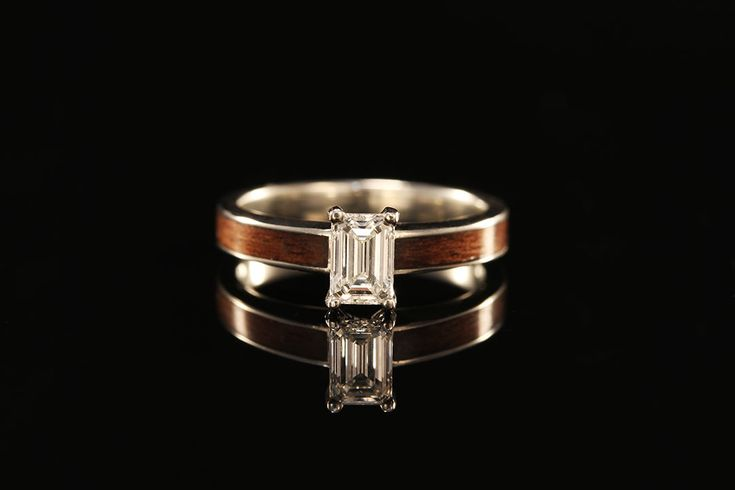 If you do not like the usual wooden ring then you can choose titanium engagement rings for her.