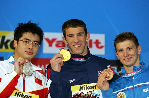 Michael Phelps Photos Photos - Michael Phelps of the USA (C) poses with his gold medal Wu Peng of China (L) poses with his silver medal and Nikolay Skvortsov of Russia poses with his bronze medal following the Men's 200m Butterfly Final during the XII FINA World Championships at the Rod Laver Arena on March 28, 2007 in Melbourne, Australia. - XII FINA World Championships - Day 12