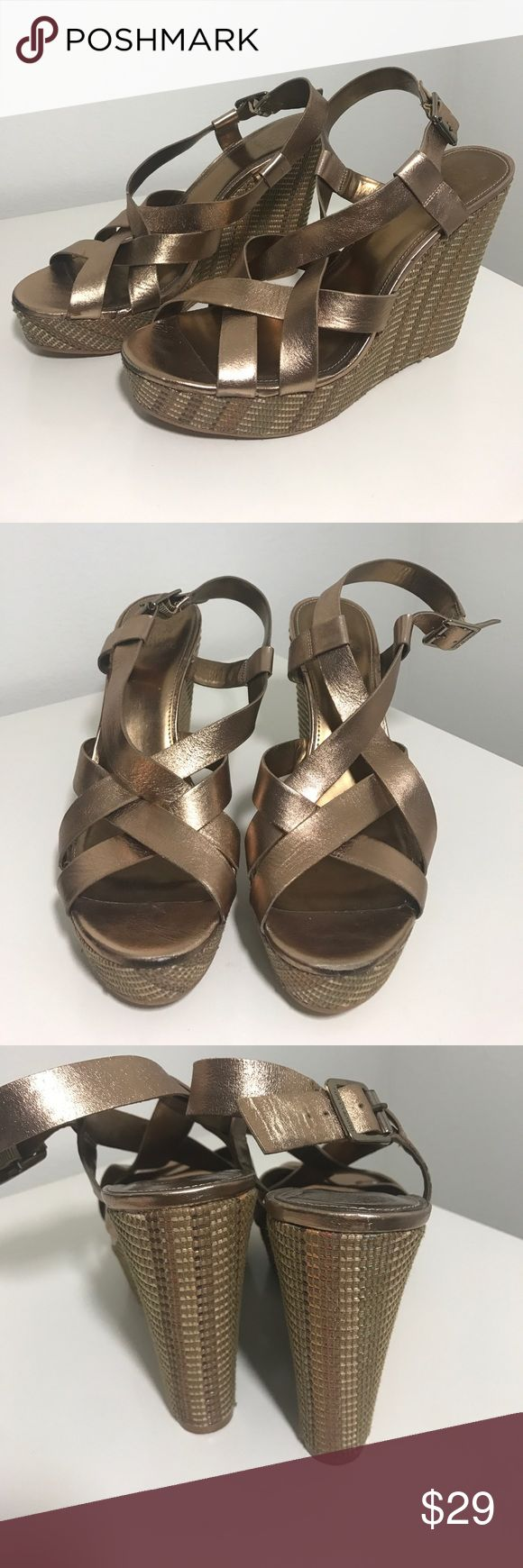 Vince Camuto wedge Upper metallic leather. Size 9. Normal wear and tear. Price firm unless bundled. 10570.23 Vince Camuto Shoes Wedges