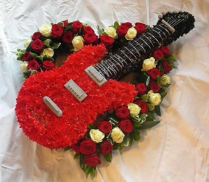 Absolutely stunning creation by Arrangement Florist using a combination of a Val Spicer Electric Guitar & an Open Heart.