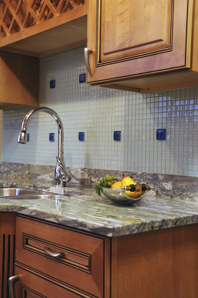 How To Remove A Granite Backsplash From A Wall Hunker Granite Backsplash Kitchen Remodel Outdoor Kitchen Countertops