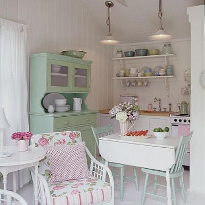Pastel colors & vintage details in a small cottage kitchen