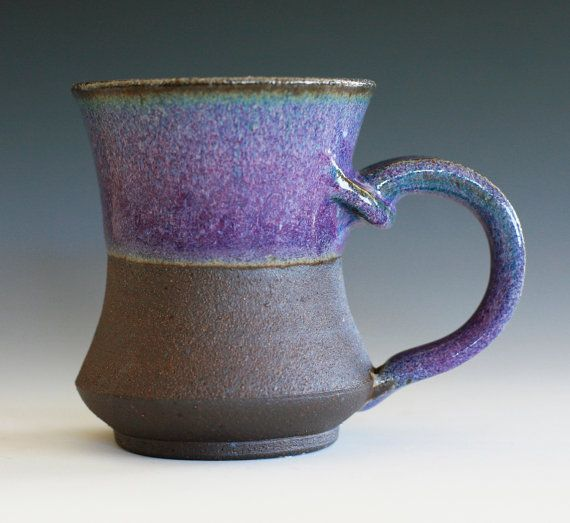 Purple Coffee Mug handmade ceramic cup ceramic by ocpottery. The dark clay used for this mug is fired to a deep, rich brown. The exterior is left unglazed with light carving that enhances the natural texture of the clay. The glazed purple interior, rim and handle give the piece a brightness of color, along with a contrast in texture with the natural clay.
