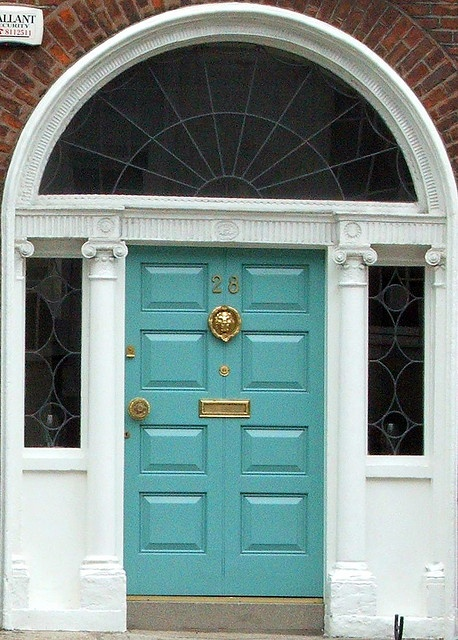 love a fresh aqua front door on a traditional brick facade.