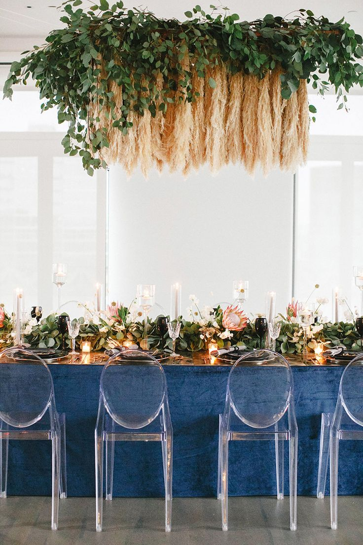 Modern Wedding Inspiration with a Pampas Grass Chandelier - photo by Leigh Miller Photography http://ruffledblog.com/modern-wedding-inspiration-with-a-pampas-grass-chandelier