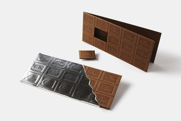 「Bise Chocolate」 Greeting card designed as a chocolate bar. Gives it reality not only by embossing the cover of chocolate patterns, but one piece of chocolate is removable from the bar. Actual tin foil from chocolate bars is used to wrap up this card.