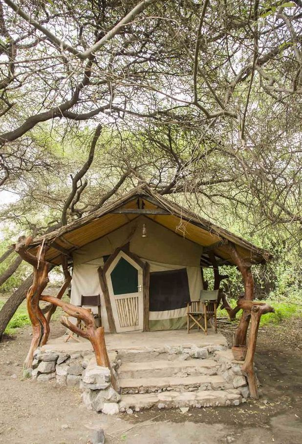 Lake Natron Camp in Tanzania is an out-of-this-world tented camp between a lake and a volcano. Timbuktu Travel.