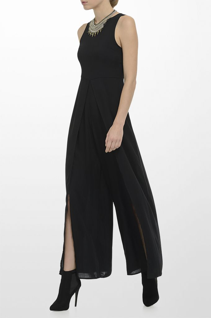 Sarah Lawrence - sleeveless jump suit, necklace.