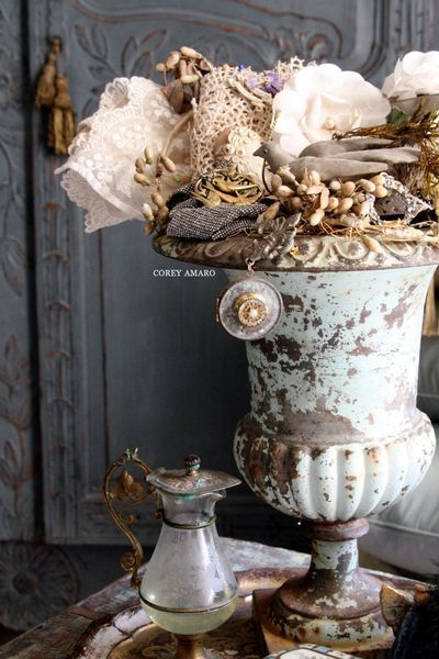 Stuffed antique French urn without flowers.