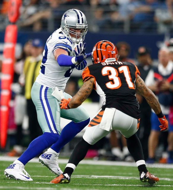 Bengals vs. Cowboys:    October 9, 2016  -  28-14, Cowboys  -     Dallas Cowboys player Jason Witten (L) runs the ball against Cincinnati Bengals player Derron Smith (R) in the first half of their game at AT
