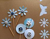 Cup cake toppers adorned with ButtonMad's handmade buttons - butterflies, flowers and circles. Celebrate in style with these gorgeous decorations. Available on Etsy.