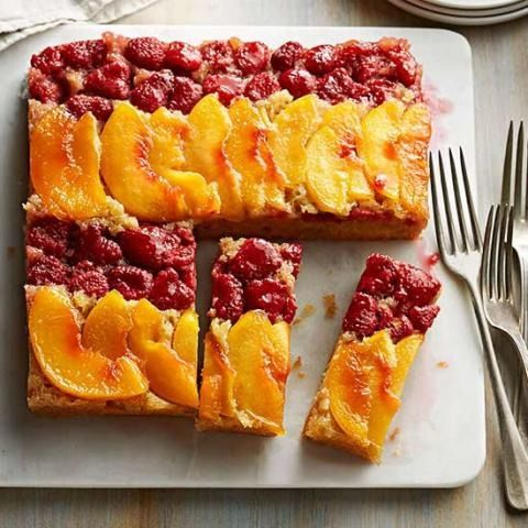 Peach Melba Upside-Down Cake: Sunny peaches and ruby raspberries dance across  a tender buttermilk cornmeal cake. It's divine with whipped cream!