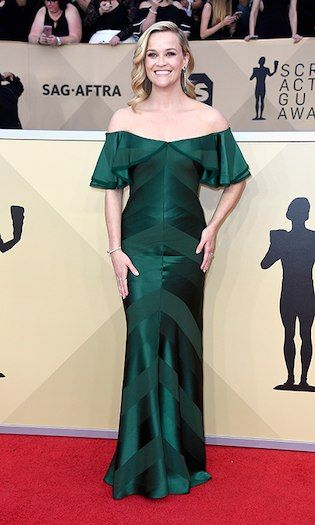 Reese Witherspoon  Her dress was telling no lies! Reese took charge on the red carpet with this regal emerald green, off-the-shoulder gown. Photo: © Getty Images 2018