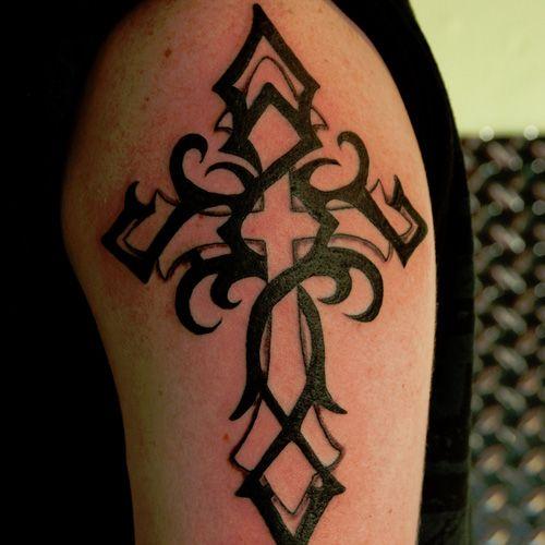 cross tattoo for men on arm | 30 Tremendous Tribal Cross Tattoos | CreativeFan