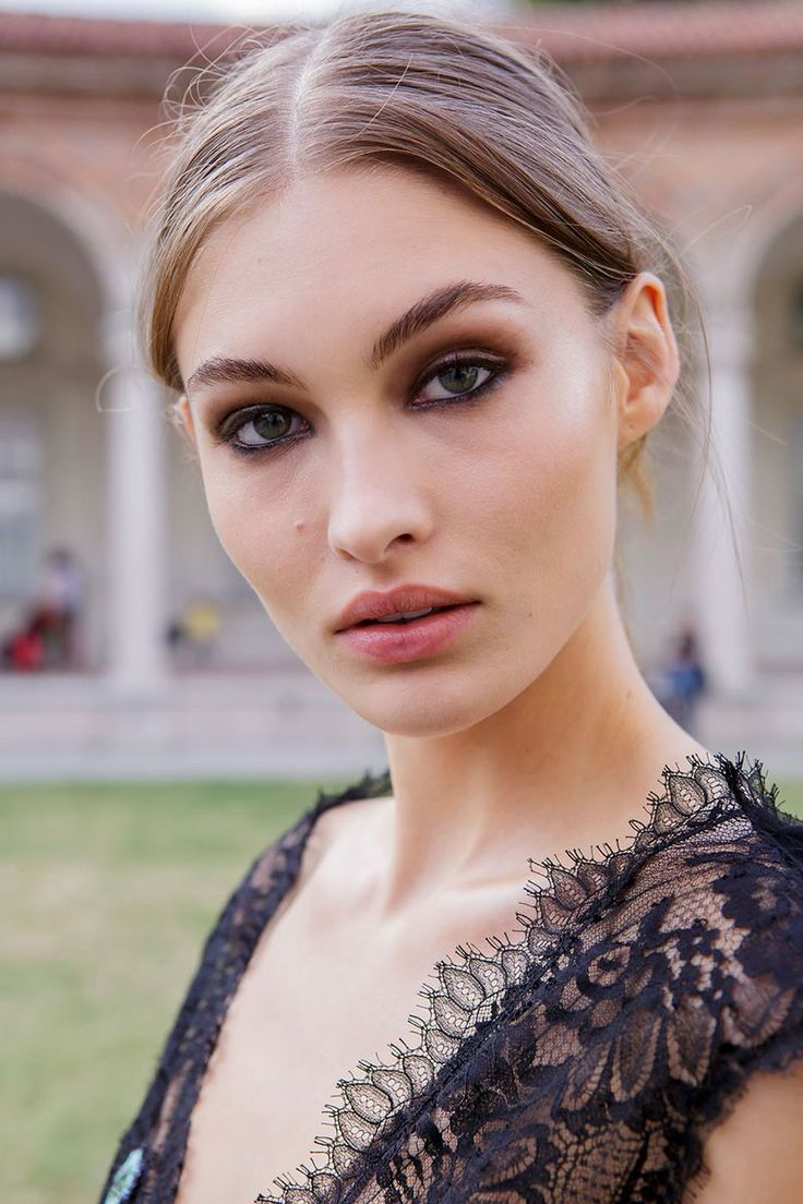 Smudged And Smoked - A mix of black and brown eyeliners and shadows gave the eyes at Alberta Ferretti an intense smoked-out effect.