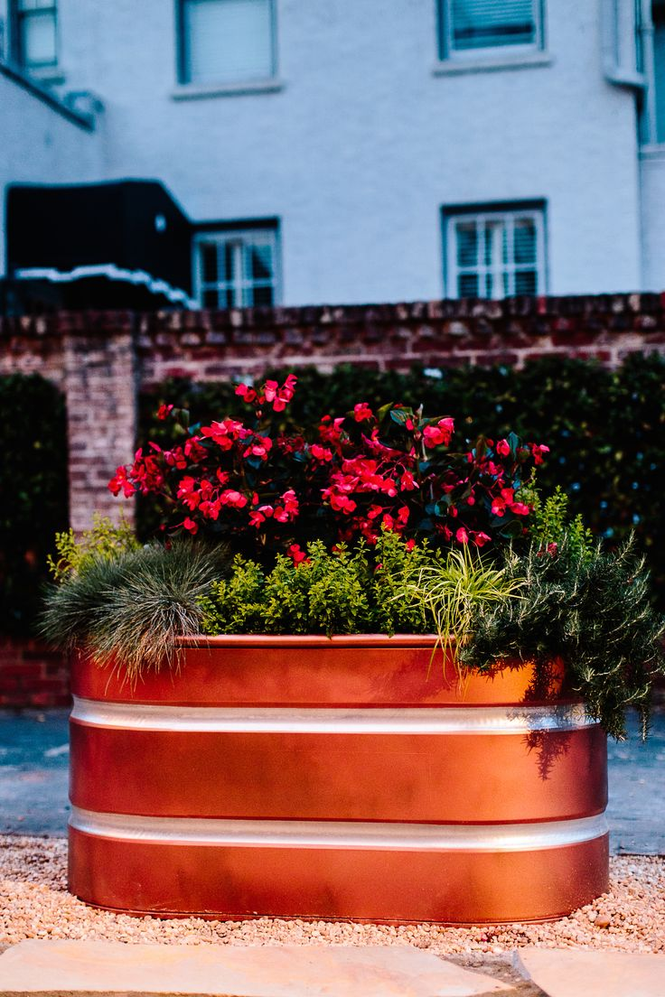 After everything weadded to our patio for The Home Depot Patio Style Challenge, my favorite element is the faux copper containers hands down! Our Patio is long and narrow and runs right along side our driveway. We needed to define the space, but didn't want to make the already narrow area feel closed in. I…