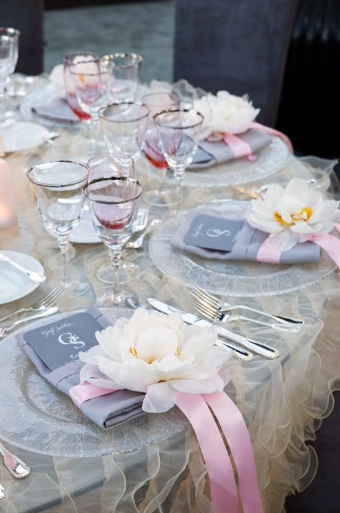 Beautiful pink and gray details at each place setting are punctuated with fluffy white peonies.