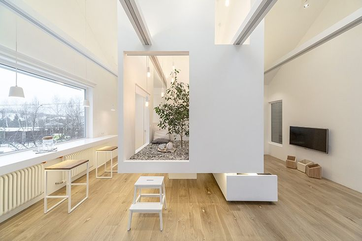 suspended at the center of the room, the residents can retreat into a peaceful space where underneath, furniture can be pulled out or stored away when needed.