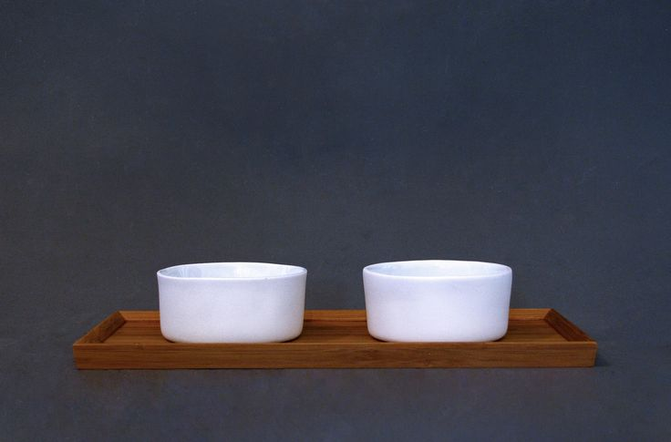 Functional ware: sake cups. Slipcast porcelain with varying glazes
