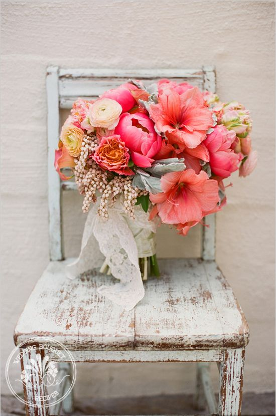 peachy pink tropical bouquet by Nancy of  Oak and the Owl Interior and Floral Design Studio; contains the following flowers: Amaryllis, Garden Roses, Calla Lily, Dutch Tulip, Dusty Miller, Peiris, Peonies, and Ranunculus.