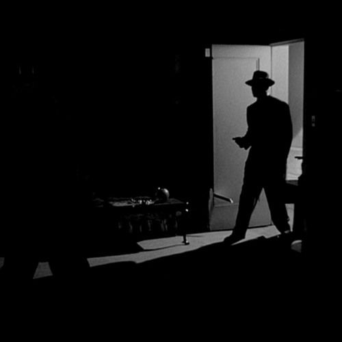 A looped piece of dark retro jazz music ideal for film noir style. Brush drums, tenor saxophone, double bass, Rhodes piano and vibraphone are playing. This piece would match the retro detective game s