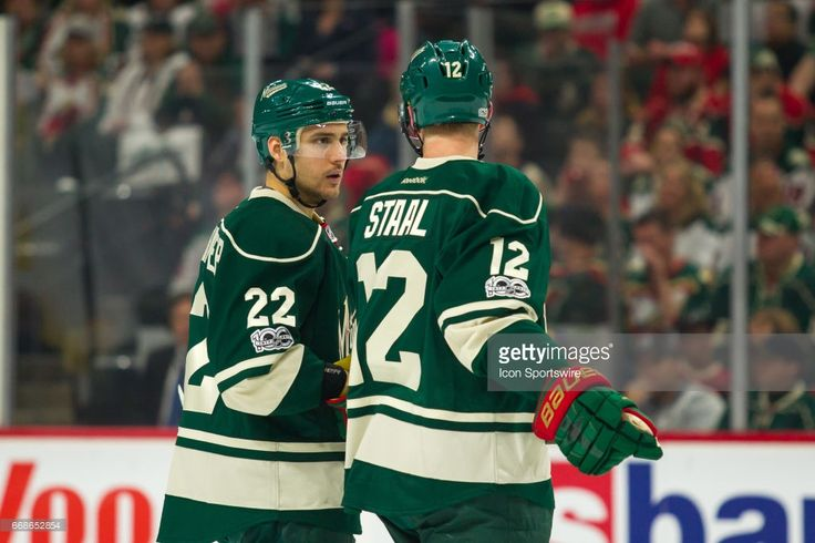 Minnesota Wild right wing Nino Niederreiter (22) talks to center Eric Staal (12) before the faceoff during Game 2 of the Western Conference Quarterfinals on April 14, 2017 at Xcel Energy Center in St. Paul, Minnesota.