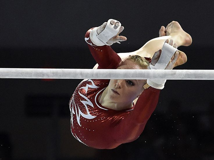 Ellie Black of Canada competes on the uneven bars in the women's gymnastic team final during the Pan Am Games in Toronto.  Eric Bolte, USA TODAY Sports
