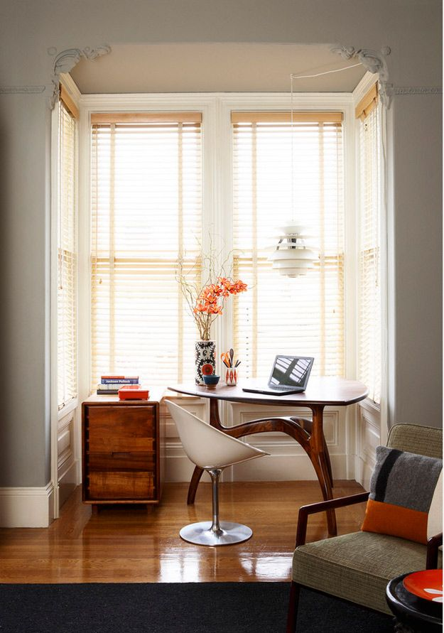 Nice usage of the space. Home office near the window