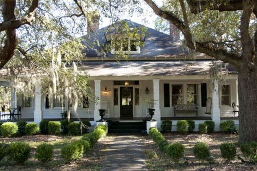 dream home...It reminds me of a front porch I saw in Alabama. I had to turn my car around and go back and take a picture