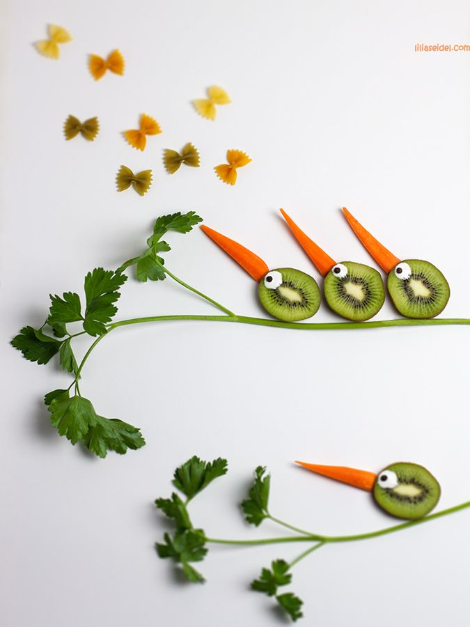 Food Art using farfalle {bowtie} pasta, parsley, kiwi fruit, carrot, and...uh...googly eyes?!  Okay, well, the rest is edible!!