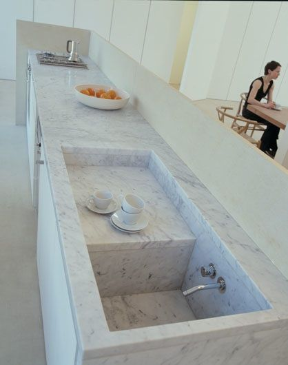 Built-in drainboard  The kitchen of UK-based architect Claudio Silvestrin; photograph by Sarah Blee