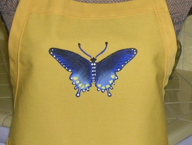Custom hand painted blue butterfly on a yellow apron.  Cost:  $24
