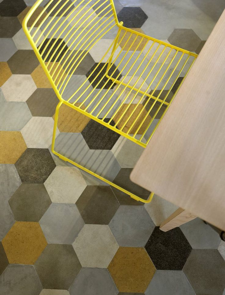 Really like the geometric shapes painted floor! And even though that yellow bar stool might leave traces on your bottoms if you sat on it for too long, it's definitely cute! (Soul, Glifada, 2012)