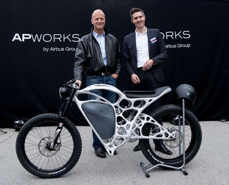 The CEOof Airbus, Tom Enders, left,  and the head of APWorks, Joachim Zettler, present the first 3D printed electric motorcycle in Ottobrunn, Germany,  Friday May 20,  2016. The motorcycle was made of metal powder by using lasermelting technology. The  bike only weighs 35 kilos.  (Sven Hoppe/dpa via AP) Photo: Sven Hoppe, AP / dpa