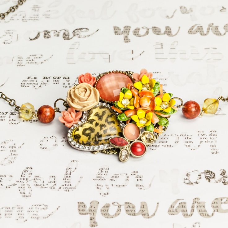 Leopard Heart Orange and Yellow Necklace, Collage Necklace, Peach necklace, flower necklace, vintage jewelry, recycled jewelry by NancyCarolsJewelry on Etsy https://www.etsy.com/listing/493637278/leopard-heart-orange-and-yellow-necklace