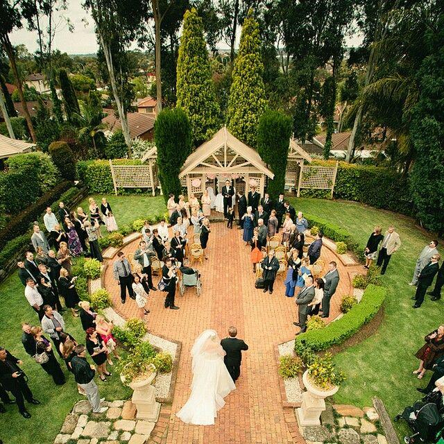 Garden wedding ceremony in progress at Eschol Park House.