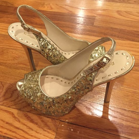 Gold sequin shoes Enzo Anglioni gold sequin shoes. They are a size 10 and were worn once! They're about 3.5 inch heels and look good with anything. Price is negotiable!!! Enzo Angiolini Shoes Heels