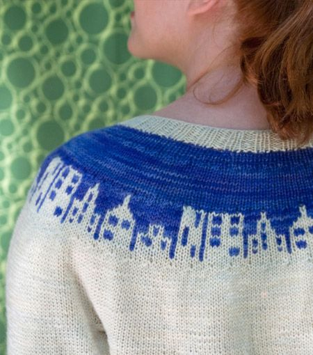 Charmingly cute Cityscape sweater.