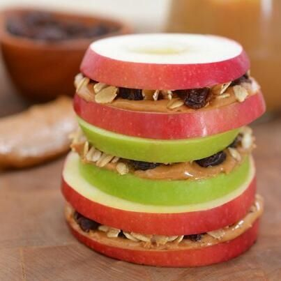 "Apple ""Sandwich"" with honeyed peanut butter, oats, & raisins."