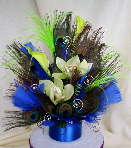 Peacock Cake Topper lime green and cobalt. Use OASIS Aluminum wire to create fun swirl shapes throughout http://sona.oasisfloral.com/products/oasis_decorative_accessories/oasis_aluminum_wire/oasis_aluminum_wire
