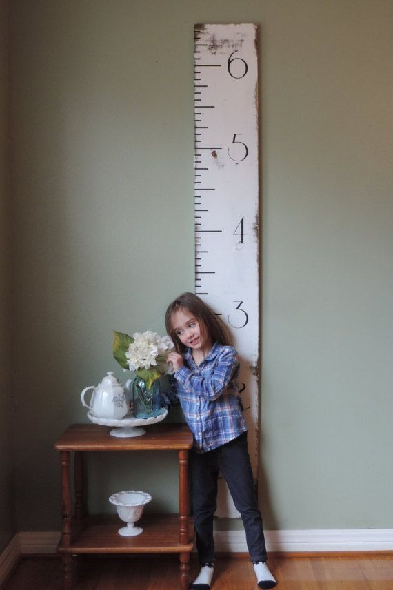 H&G Designs growth charts undergo a process to provide you with a custom piece that will last generations to come. We hand select each piece of wood to assure you that no board is damaged. We then sand, stain/paint and seal with polycrylic or wax. A flush wall mount hanger is placed on the back of each board to provide ease when hanging.  Our boards are 6 tall and 10 wide. Each board is hung 6 off of floor and will measure up to 66.  Dont see a color you like...message me, and we wil...