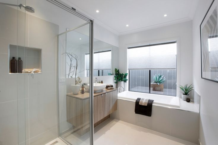 Simple european city style is reflected in this main for Main bathroom designs